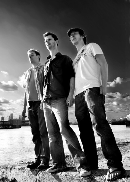 Very post-processed image of the band standing on the banks of the Thames